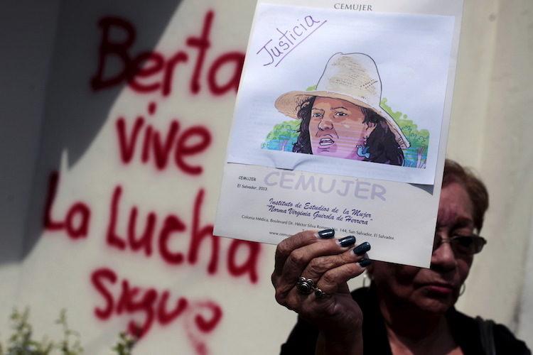 Activist hold a photo of slain environmental rights activist Berta Caceres during a protest at the Honduran embassy in San Salvador